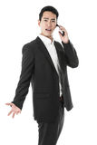 Unhappy businessman answering a phone call Stock Photos