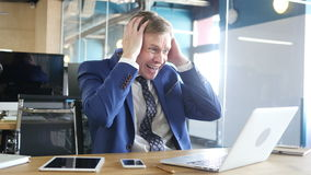 Unhappy businessman with computer getting bad news in office. Unhappy businessman with computer getting bad news in office, young man , freelancer stock footage