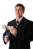 Unhappy Businessman Cutting Dollar Bill Royalty Free Stock Images