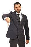 Unhappy businessman give thumb down Stock Photo