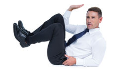 An unhappy businessman holding something Royalty Free Stock Image