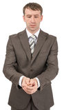 Unhappy businessman looking at his hands Stock Photos