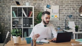 Unhappy businessman looking at papers laptop screen yelling throwing documents stock footage