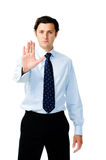 Unhappy businessman shows 'stop!' Stock Photography
