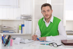 Unhappy businessman sitting concerned and frustrated at office. Stock Images