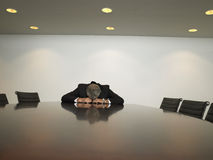 Unhappy Businessman Sitting In Conference Room Royalty Free Stock Photos