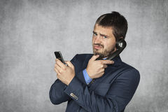 Unhappy businessman talking on the phone Royalty Free Stock Photos
