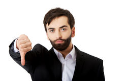 Unhappy businessman with thumbs down gesture. Stock Photo