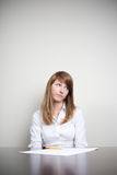 Unhappy businesswoman. Unhappy business woman sitting with document Royalty Free Stock Photo