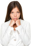 Unhappy Businesswoman With Hands On Chin Royalty Free Stock Photos