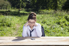Unhappy businesswoman from the place where it delegated Royalty Free Stock Photo