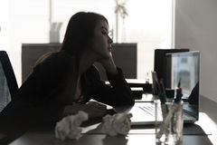 Unhappy businesswoman sitting at desk Royalty Free Stock Image