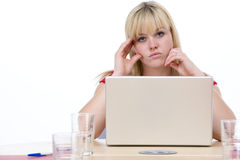 Unhappy Businesswoman sitting with laptop Stock Image