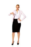 Unhappy businesswoman with thumbs down gesture Royalty Free Stock Photo