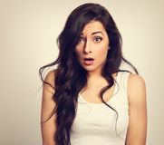 Unhappy casual surprising woman in white short with big eyes and Stock Images