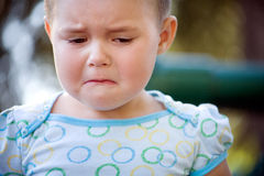 Unhappy child. Small girl is unhappy and crying Royalty Free Stock Images
