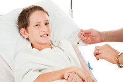 Unhappy Child Getting Injection Stock Photo