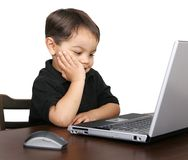 Unhappy child at laptop Royalty Free Stock Photography