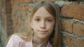 Unhappy Child Looking in Camera, Sad Girl Portrait, Depressed Bored Kid Face stock image