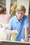 Unhappy Children Helping to Clean House Stock Photography