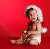 Unhappy christmas baby. Crying on red background Stock Photo