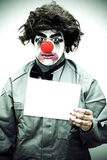 Unhappy Clown Holding Sign Stock Image