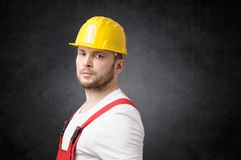 Disappointed construction worker. Unhappy construction worker with yellow hard hat Royalty Free Stock Image