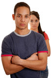 Unhappy couple. Unhappy teenage couple over white background Stock Photo