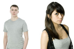 Unhappy couple. Girlfriend infront with unhappy boyfriend behind Stock Photo