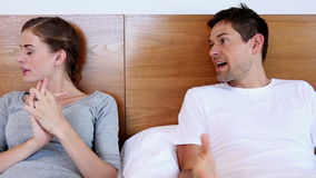Unhappy couple arguing on bed stock video footage