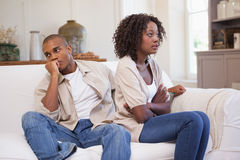 Unhappy couple arguing on the couch Royalty Free Stock Photography