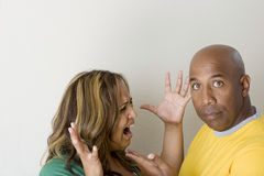 Unhappy couple arguing and having relationship problems. Royalty Free Stock Image