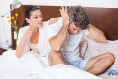 Unhappy couple in a bed, conflict problem Royalty Free Stock Photography