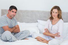 Unhappy couple in bed Stock Images