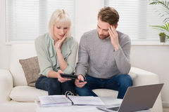 Unhappy Couple Calculating Bills Stock Images