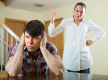 Unhappy couple during conflict. Unhappy guy and sad women during conflict at home Stock Images
