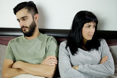 Unhappy couple after fight in bed not talking Royalty Free Stock Photo