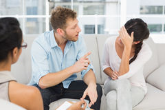 Unhappy couple fighting at therapy session Royalty Free Stock Photos