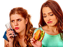 Unhappy couple girl eating fast food Royalty Free Stock Photos