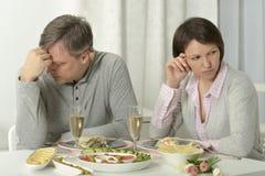 Unhappy couple have dinner Stock Photos