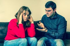 Unhappy couple having argument at home Stock Photo