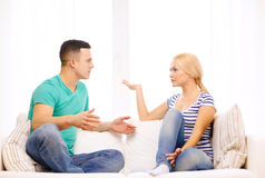 Unhappy couple having argument at home Royalty Free Stock Image
