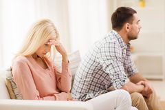 Unhappy couple having argument at home Stock Images