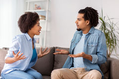 Unhappy couple having argument at home. People, relationship difficulties, conflict and family concept - unhappy couple having argument at home royalty free stock photo