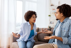 Unhappy couple having argument at home. People, relationship difficulties, conflict and family concept - unhappy couple having argument at home stock photo