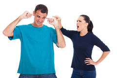 Couple having argument. Unhappy couple having an argument isolated on whit background Royalty Free Stock Images