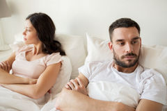 Unhappy couple having conflict in bed at home Stock Photography
