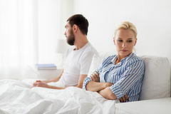 Unhappy couple having conflict in bed at home Royalty Free Stock Photo