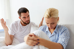 Unhappy couple having conflict in bed at home Royalty Free Stock Photography