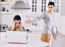 Unhappy couple in the kitchen. Unhappy couple offended in the kitchen royalty free stock photos